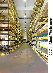 Shelves with wood building materials in warehouse