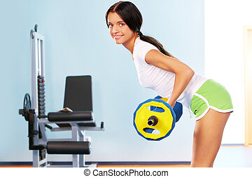 Building muscle - Photo of active girl lifting dumbbell - ...