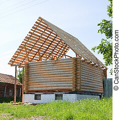 building new wooden house in sunny day