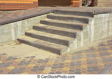 Building new house entry steps with pavement outdoor.