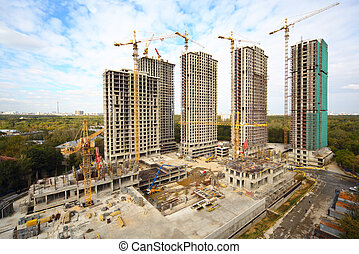 Building of high-rise apartment in the forest zone at summer day