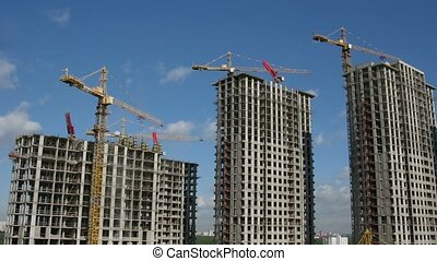 Building of many storeyed buildings. Time lapse.