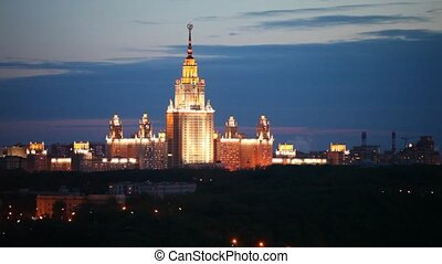 Building of Moscow State university stands against night sky...