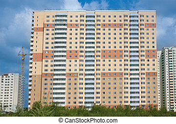 Building of new residential area - Facade of new inhabited...