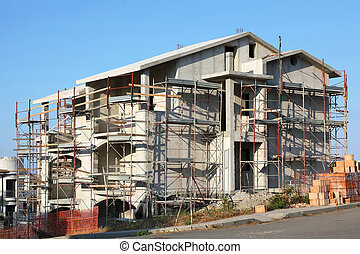 Building of new three-storeyed cottage near road in resort ...