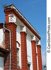 Building of red brick with columns