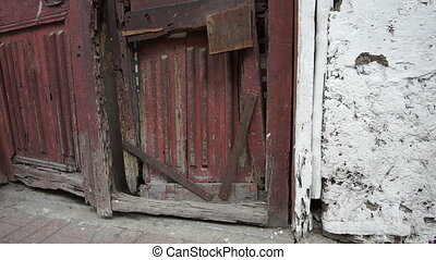 Building Old Wooden Wrecked Door - Tilt up shot of an old...