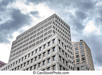 Building on a background of cloudy sky.