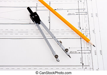 Building plan of reinforced concrete construction with compasses and pencil