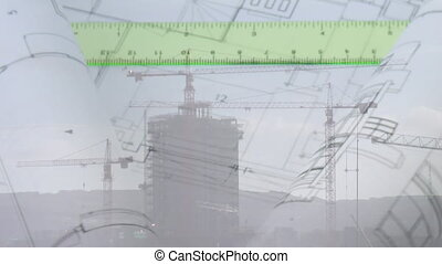 Building plans and a ruler