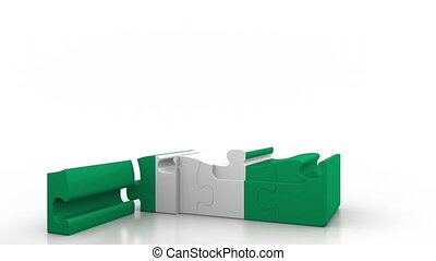 Building puzzle house featuring flag of Nigeria. Nigerian...