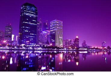 Building reflect water at night in Bangkok