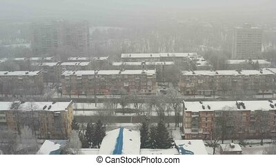 Building roof covered with snow. - Aerial view of building...