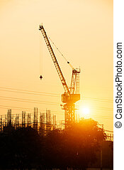 Building site and electric pylon at sunset