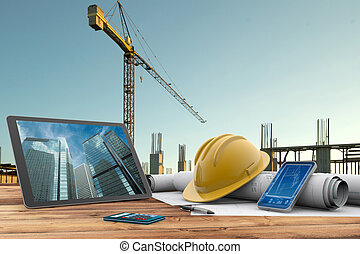 building site - blueprints, safety helmet and computer in ...