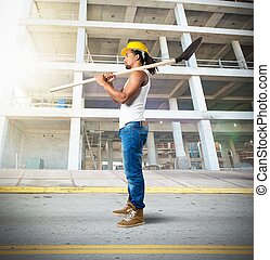 Sexy mason working on a building site