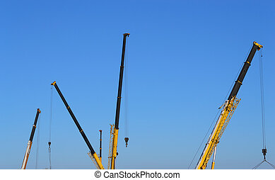 Building site - Truck crane boom on the blue sky background...