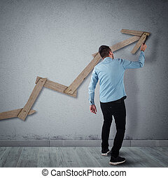 Building success - Man builds with a hammer an arrow