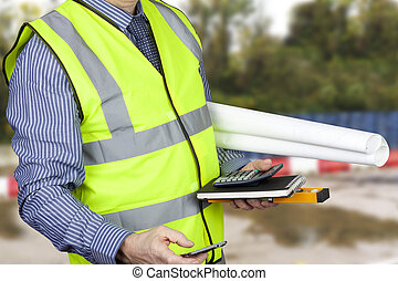 Building surveyor in hi vis carrying site plans and calculator