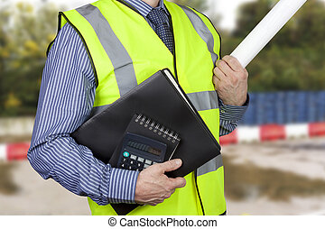 Building surveyor in hi vis carrying work folders and calculator with site plans under his arm