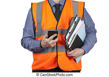 Building Surveyor in orange visibility vest carrying folders and phone