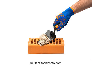 Building trowel in male hand with construction gloves