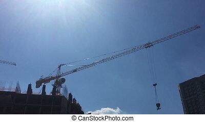 Building Under Construction, Crane against the blue sky