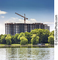 Building under construction on the bank of big lake