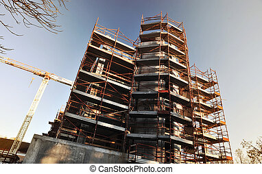 building under construction. Safety guard rails, and tower ...