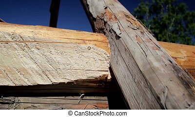 Building up a old historic cabin log house using a log