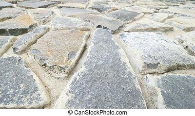 Building wall built from broken flat stones. Old stony wall...