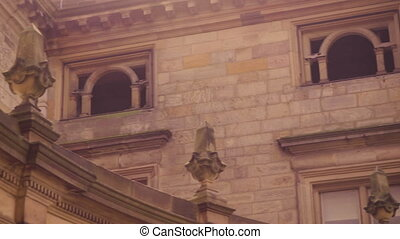 Building windows and ledge with stone sculputes - A panning ...