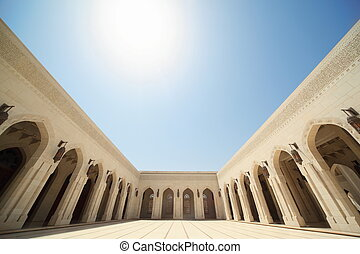 building with arcs inside Grand Mosque in Oman. Wide Angle.