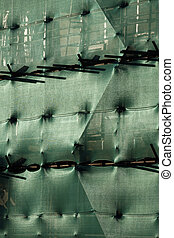 Building with scaffolding and green netting