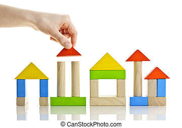 Building with wooden blocks - Hand building houses of wooden...