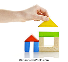 Building with wooden blocks - Wooden block houses under...