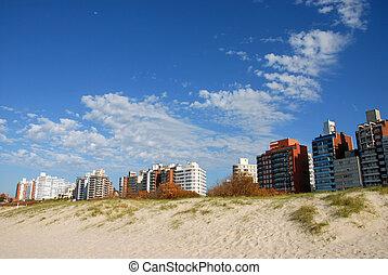 Buildings a sand dune. Punta del Este, Uruguay