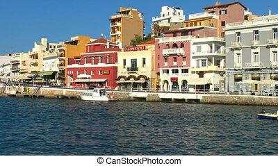 Buildings along sea coast before sunset, Agios Nikolaos,...