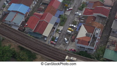 Buildings and railway with a passing train in city of Kuala Lumpur, Malaysia