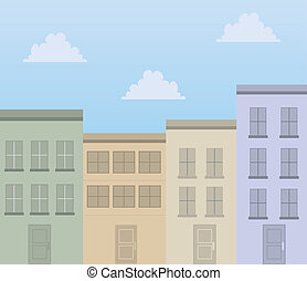Apartment buildings in front of blue sky