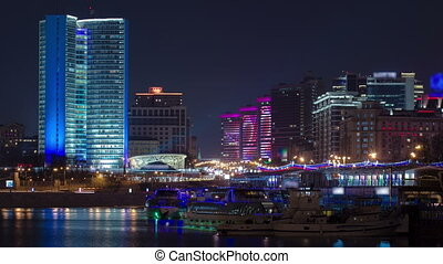 Buildings at New Arbat Street after sunset timelapse. New Arbat is located in the central part of Moscow