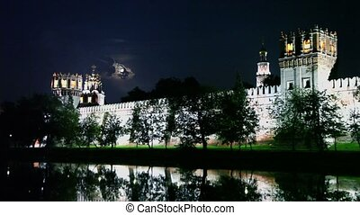 Buildings beyond wall of Novodevichy Convent with illumination