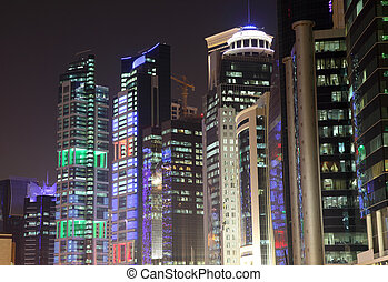 Buildings downtown in Doha at night. Qatar, Middle East