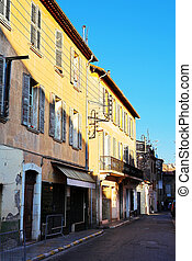 Buildings in Antibes - Building with shutters on windows in...