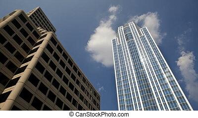 Buildings in Cincinnati - Timelapse of clouds behind a...