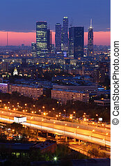 Buildings of Moscow City complex of skyscrapers at evening in Moscow, Russia; sunset
