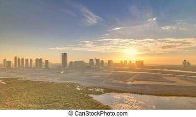 Buildings on Al Reem island in Abu Dhabi at sunset timelapse...