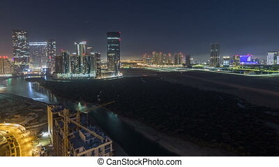 Buildings on Al Reem island in Abu Dhabi night timelapse...
