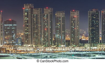 Buildings on Al Reem island in Abu Dhabi night timelapse...