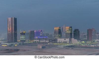 Buildings on Al Reem island in Abu Dhabi night to day...